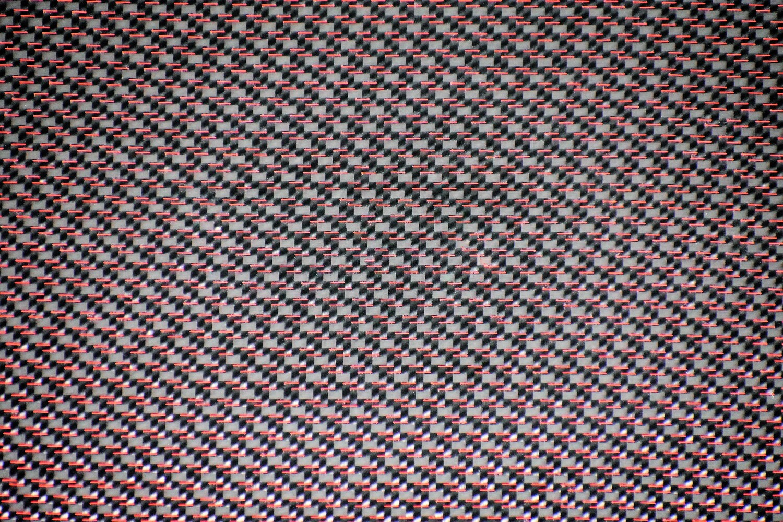Carbon fiber with red nylon strand